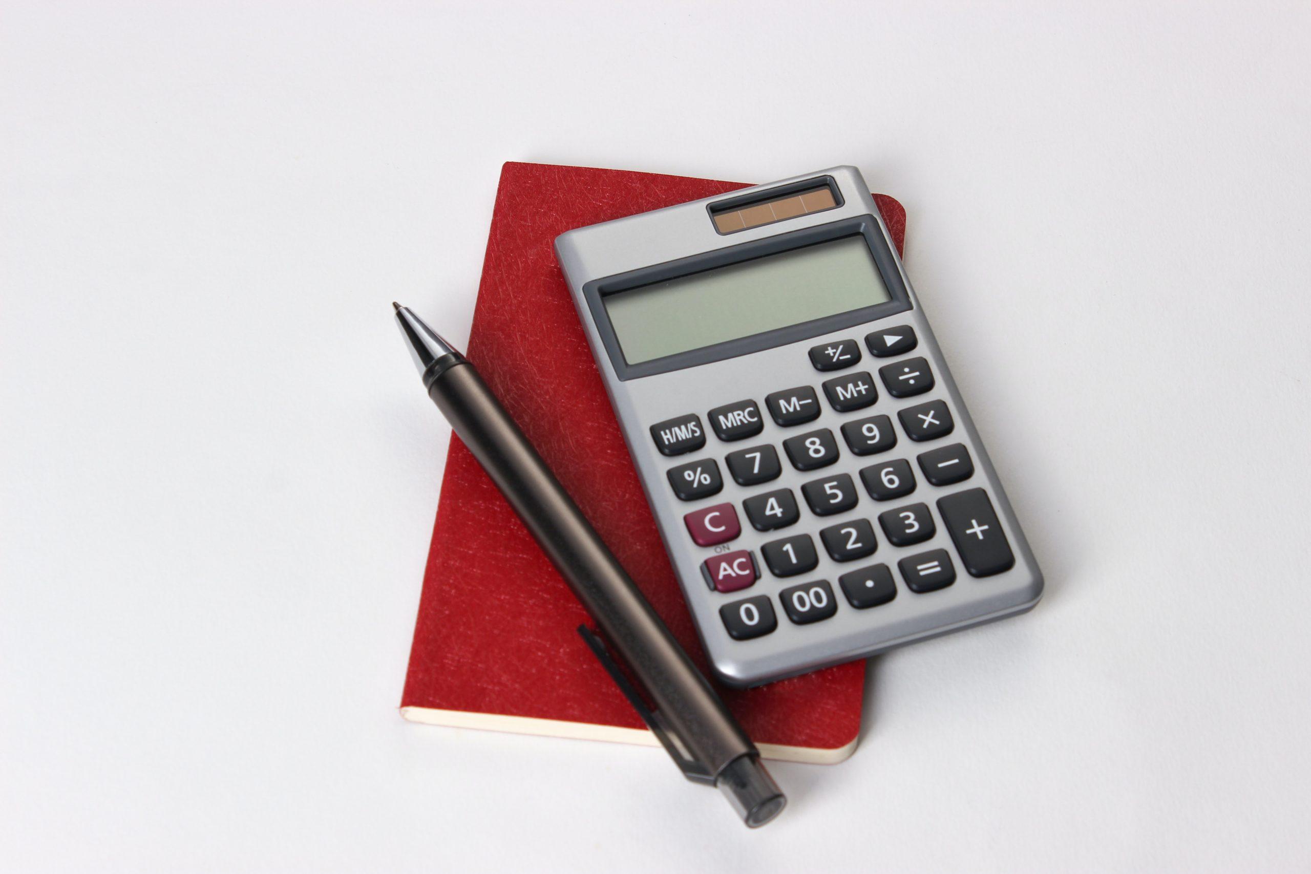pocket book, pocket calculator, pen
